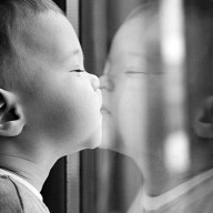 baby-kissing-on-mirror