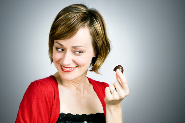 happy-woman-eating-dark-chocolate