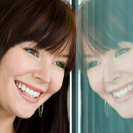 woman-smiling-into-mirror